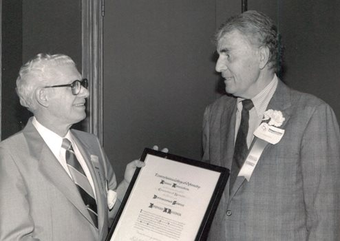 Mr. Hueber accepting award from Dr. Harry Kaplan '49