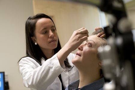 PCO_Optometry_student-giving-eye-drops-to-patient_1.jpg
