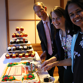 Drs. Mittelman, Bondurant and Aravamudhan cut into the cake