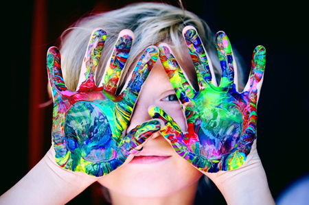 kid with painted hands