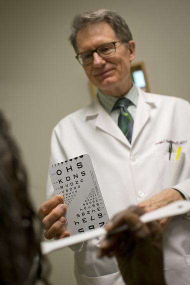 Dr. with eye chart