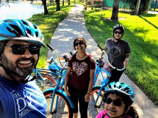 Dr. Rajan and family cycling